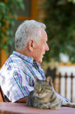 Man and cat. Senior sleepy man with cat Royalty Free Stock Image