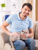 Man with cat Royalty Free Stock Photography