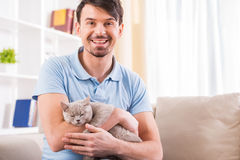 Man with cat Royalty Free Stock Photos