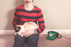 Man with cat and telephone Royalty Free Stock Image