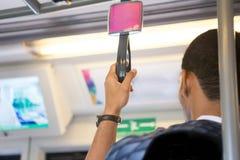 Man catch Handrails on train. Bangkok Thailand on blurred background stock photo