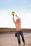 Man catching beach ball Stock Photography