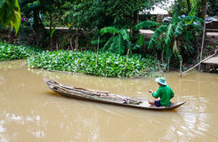 Man catching catfish in the Mekong river Stock Photos