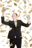 Man catching dollars under a dollar rain Royalty Free Stock Photos