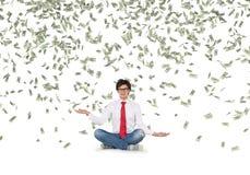 Man catching falling dollar bills Royalty Free Stock Photos
