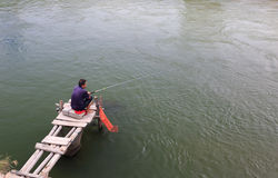 Man catching fish Royalty Free Stock Images