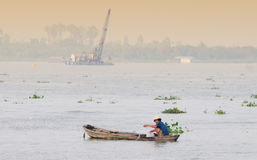 A man catching fish on Mekong river in Tra Vinh, Vietnam Royalty Free Stock Images