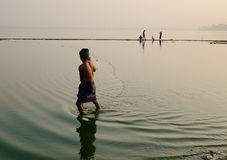 A man catching fishes on the lake in Mandalay, Myanmar Royalty Free Stock Images