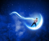 Man catching moon Royalty Free Stock Photography