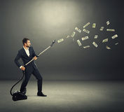 Man catching paper money Royalty Free Stock Photography