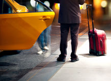 Man catching a taxi Royalty Free Stock Images