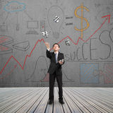 Man catching and throwing money Stock Photo