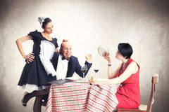 Man caught with his lover by his wife. In a restaurant Royalty Free Stock Images