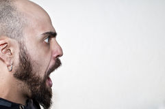Man caught with his mouth open. On white background Royalty Free Stock Photography