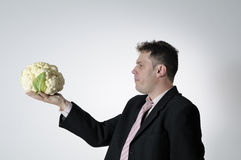 Man with cauliflower Royalty Free Stock Image