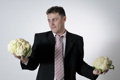 Man with cauliflowers Royalty Free Stock Photography