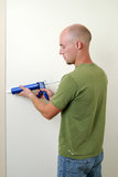 Man caulking a doorway Stock Photo
