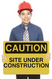 Man With A Caution Sign Royalty Free Stock Photography