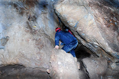 Man in cave Stock Images