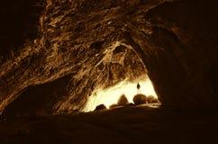 Man at cave entrance Royalty Free Stock Photo