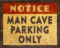 Man Cave Parking Sign. Man Cave Parking Only Sign grunge vintage rustic for garage cars boats motorcycles bikes stock photo