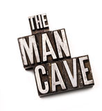 Man Cave. The phrase The Man Cave in letterpress type. Cross processed, narrow focus Royalty Free Stock Image