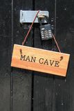 Man cave sign. With lock on door Royalty Free Stock Photography