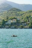 Man in cayak in Ascona on Lake Maggiore. Ascona, Switzerland - August 23, 2016: Man in cayak in the Boat in Ascona on Lake Maggiore in Ticino canton in Stock Photos