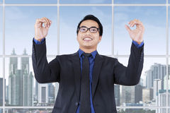 Man celebrate his achievement near the window Royalty Free Stock Photography