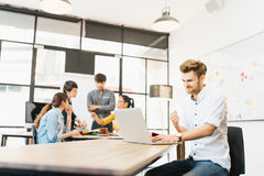 Man celebrate success pose with multi-ethnic diverse team meeting at office. Creative group, business coworker, or college student. Man celebrate success pose stock photography