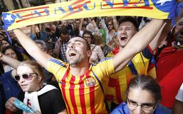 A man celebrates that Catalonia declared independence from Spain. Thousands wave flags and celebrate in the streets of Barcelona on October 27, 2017, following royalty free stock images