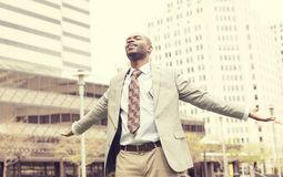 Man celebrates freedom success arms raised looking up Stock Images