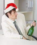 Man celebrates new year with wine bottle Royalty Free Stock Photos