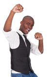 Man celebrates by pumping fists Royalty Free Stock Images