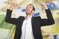 Man celebrates winning. At lottery , with arms up royalty free stock images