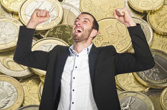 Man celebrates winning. At lottery , with arms up royalty free stock image