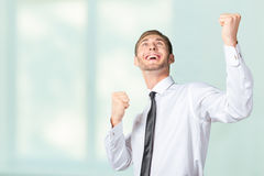 Man celebrating with arms up Royalty Free Stock Images