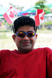 Man celebrating Canada Day stock images