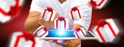 Man celebrating christmas holding gift in his hand. Man holding white and red flying gift boxes Royalty Free Stock Images