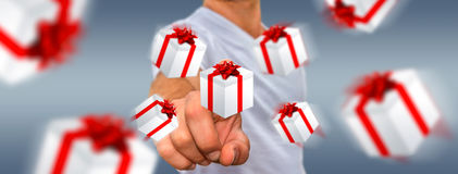 Man celebrating christmas holding gift in his hand. Man holding white and red flying gift boxes Royalty Free Stock Photo