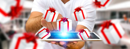 Man celebrating christmas holding gift in his hand. Man holding white and red flying gift boxes Royalty Free Stock Image