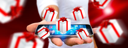 Man celebrating christmas holding gift in his hand. Man holding white and red flying gift boxes Stock Images