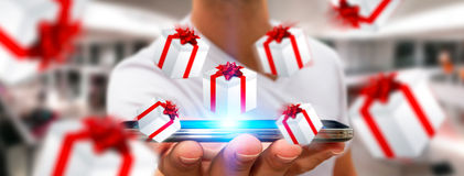 Man celebrating christmas holding gift in his hand. Man holding white and red flying gift boxes Stock Photo
