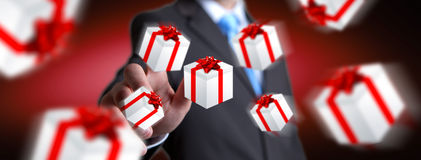 Man celebrating christmas holding gift in his hand. Man holding white and red flying gift boxes Royalty Free Stock Photos