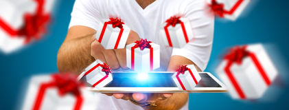 Man celebrating christmas holding gift in his hand. Man holding white and red flying gift boxes Stock Photography