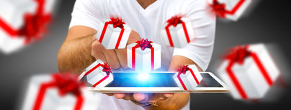 Man celebrating christmas holding gift in his hand. Man holding white and red flying gift boxes Royalty Free Stock Photography
