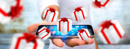 Man celebrating christmas holding gift in his hand. Man holding white and red flying gift boxes Stock Image