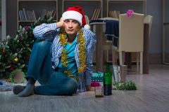The man celebrating christmas at home alone. Man celebrating christmas at home alone Royalty Free Stock Image