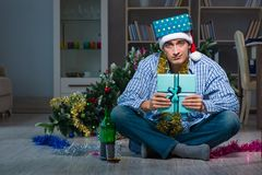 The man celebrating christmas at home alone. Man celebrating christmas at home alone Stock Photo
