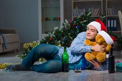 The man celebrating christmas at home alone. Man celebrating christmas at home alone Stock Image